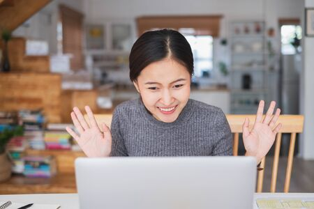 Young Asian businesswoman work at home and virtual video conference meeting with colleagues business people, online working, video call due to social distancing Reklamní fotografie