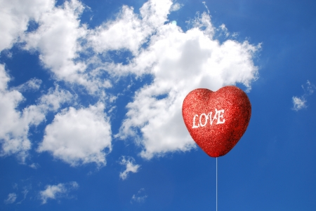 Heart balloon with blues sky photo