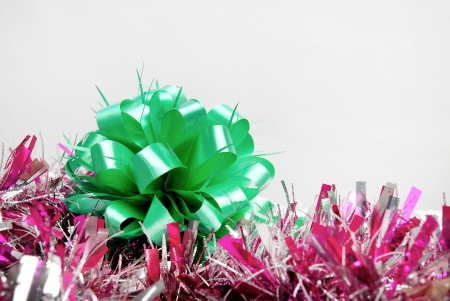 Green bow with pink garland photo