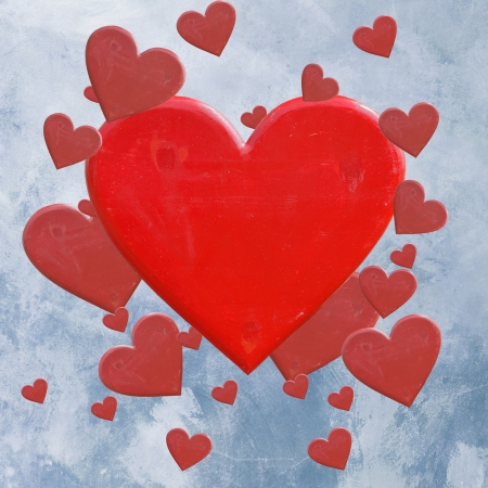 Red hearts on blue grunge background photo