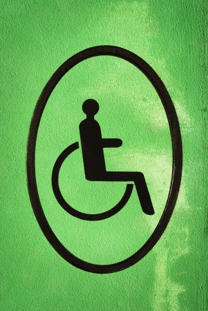 disabled sign on green grunge wall photo