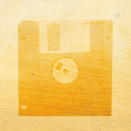Diskette icon on grunge background photo