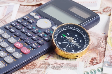 compass and calculator on money Stock Photo - 18713612