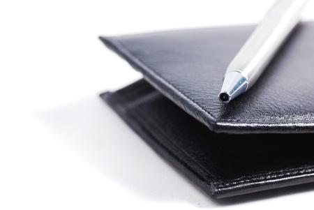 silver pen on black wallet photo