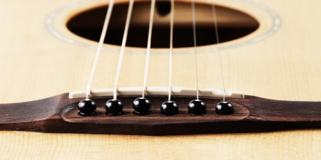 solo form: Close up of bridge pin and sound ,acoustic guitar Stock Photo