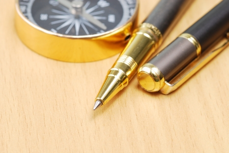 business dicision, compass and pen photo
