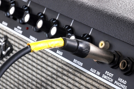 black guitar amplifier with yellow cord photo
