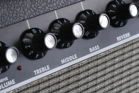 button of guitar amplifier photo