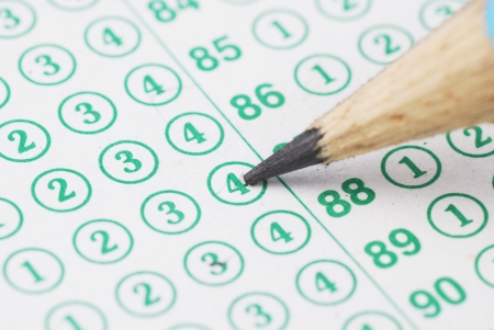 eraser mark: Pencils point at choice No.4 on blank test sheet close up
