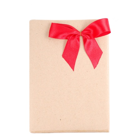 Vintage gift box with red ribbon bow photo