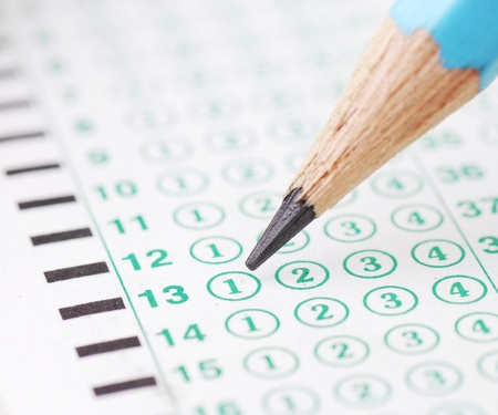 eraser mark: Pencils point at choice No.1  on blank test sheet close up