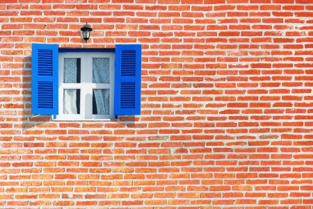 Blue windows on brick wall background photo