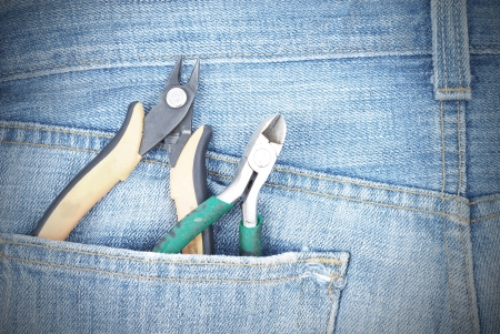 Blue jeans pocket with pliers photo