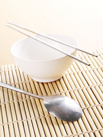 asian dish place setting on bamboo mat photo