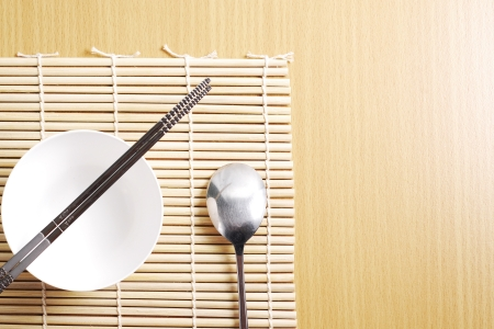Asian dish place setting on bamboo mat, Korean style Stock Photo