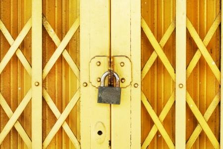 lock on yellow steel door