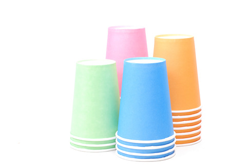 stack of colorful recycling paper glass on white background photo
