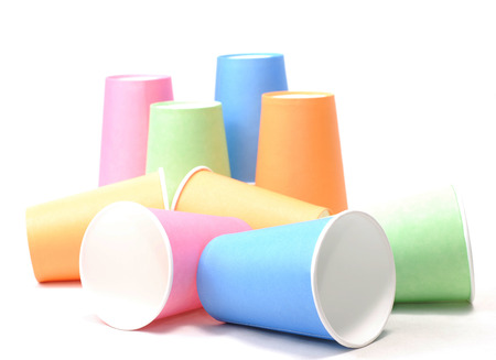 stack of recycling colorful paper glass on white background photo