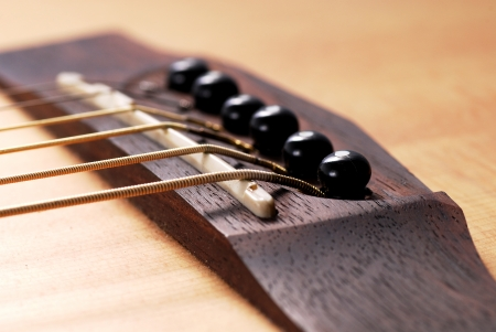 solo form: Close up of bridge pin, acoustic guitar