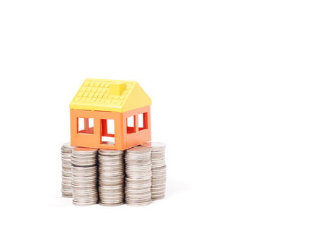 House model on stack of coins photo