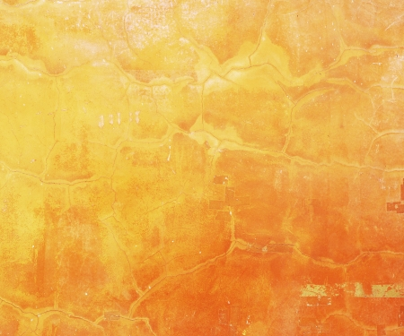 Yellow grunge cement wall background