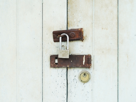 lock on old white wood door photo