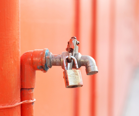 desalination: iron faucet water with lock Stock Photo