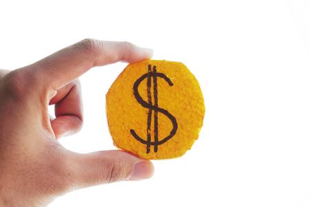 fake money: Hand hold dollar coin Stock Photo