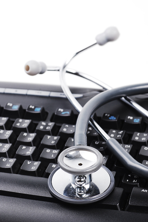 Stethoscope on keyboard background