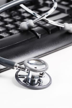 Stethoscope on keyboard background