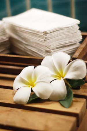 Frangipani flower with stack of white towel Stock Photo