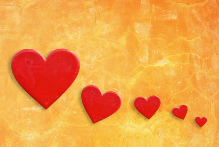 Five hearts on yellow wall background