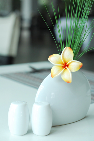 Frangipani flower on dining table setting Stock Photo
