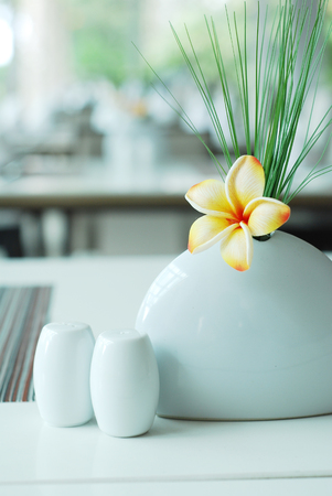 Frangipani flower on dining table setting Stock Photo