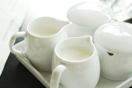 White Cup of Milk on a light Background Stock Photo