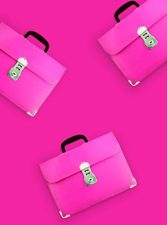Leather School Bag Hanging on pink background - photo 版權商用圖片