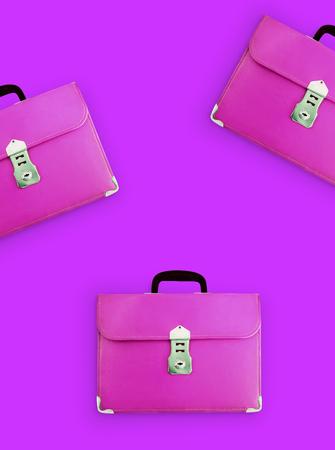 Leather School Bag Hanging on pink background - photo Standard-Bild