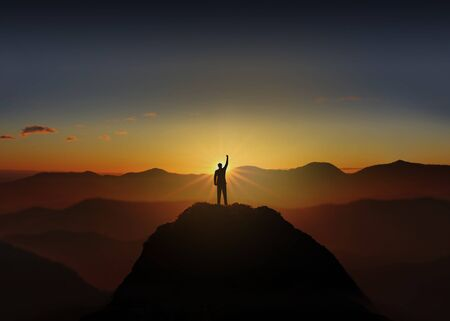 Success Concept. Silhouette of business man are celebrating success on top mountain, sky and sun light background. Фото со стока