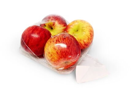 Apples in plastic package on white background. - Image Stockfoto - 129979539