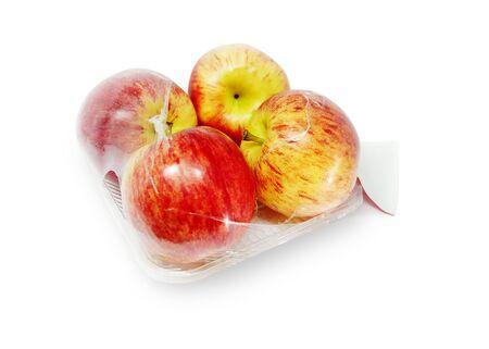 Apples in plastic package on white background. - Image 版權商用圖片