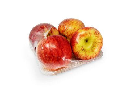 Apples in plastic package on white background. - Image Standard-Bild