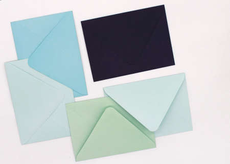 blue-tone paper envelopes on a white background