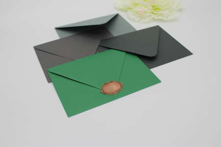 green tone envelope with blank paper