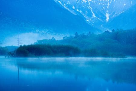 early morning: Early morning at spring Kamikochi Taisho-ike pond,nagano,japan
