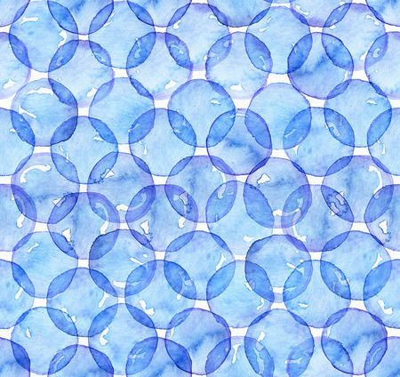 Seamless watercolor texture, based on blue hand drawn imperfect circles in a geometric repeating design. Square pattern, good for fabric, wrapping paper design. Blue circles overlapped