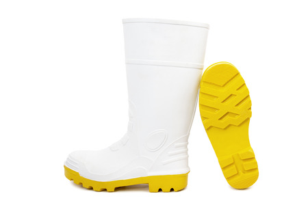 White Gumboots with Yellow Soles Isolated on White Background Stock Photo