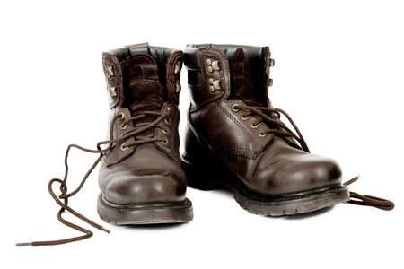 Untied Work Boots after a days work, Isolated on White Background