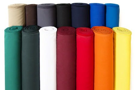 Multiple Rolls of Colorful Fabric Isolated on White Background