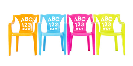 Colorful Kids Chairs Isolated on White Background photo