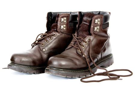 zapatos de seguridad: Botas de trabajo no vinculados aisladas sobre fondo blanco